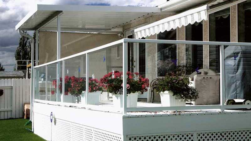 Glass railing with aluminum posts on a deck