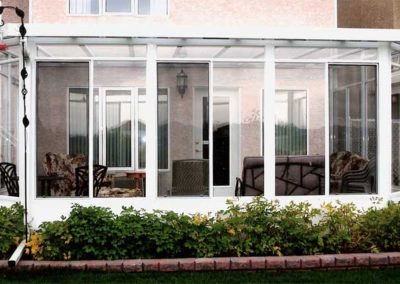 Glass wall and glass roof sunroom