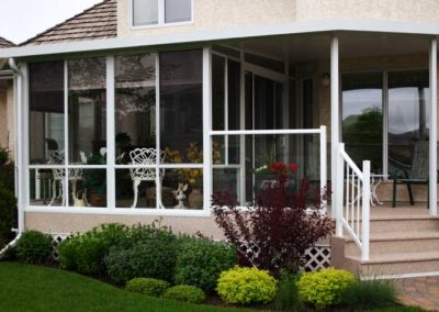 White aluminum sunroom in Saskatoon Saskatchewan with glass railing
