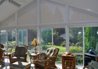 Interior of sunroom with peaked roof