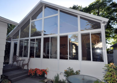 Glass panelled peaked roof solarium in Saskatoon