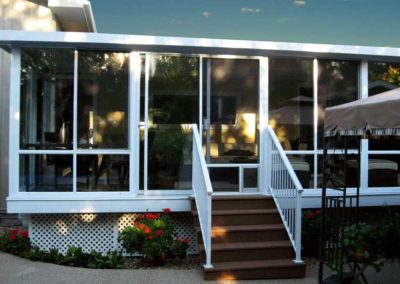 White aluminum all glass walled sunroom