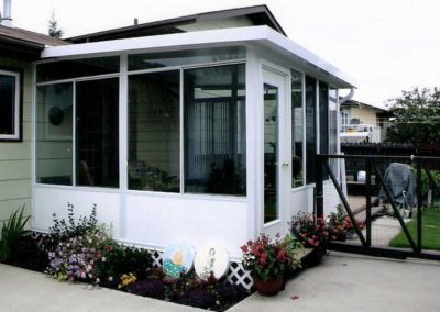 White sunroom with glass and polar insulated panels
