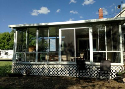 Two season aluminum and glass sunroom on raised deck