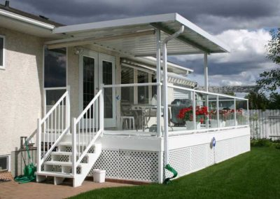 Aluminum glass and picket railings with small patio cover