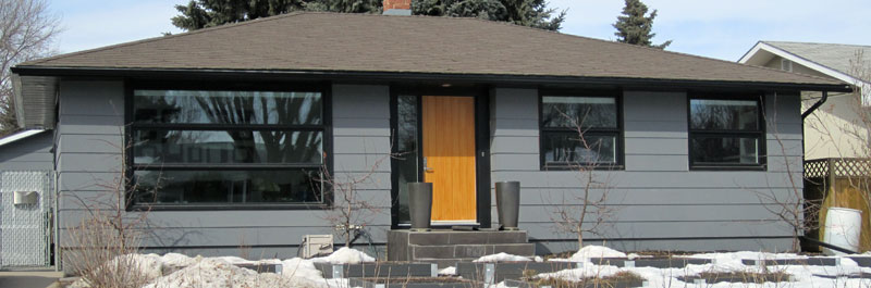 Light stained insulated wood door to home in Saskatoon