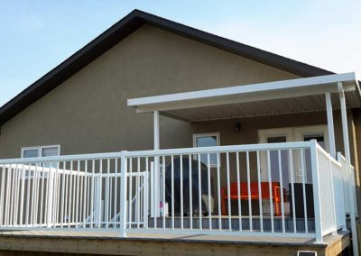 Small patio cover and white aluminum rails