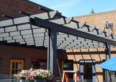 Dark aluminum pergola at Fudruckers Saskatoon on their patio