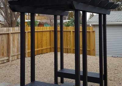 Aluminum pergola in backyard with built in benches
