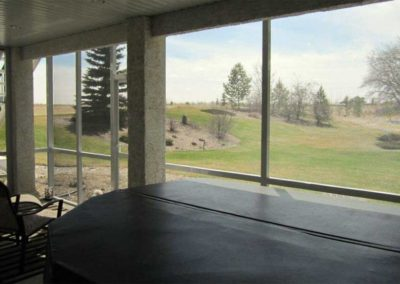Screen room with hot tub and prairie view